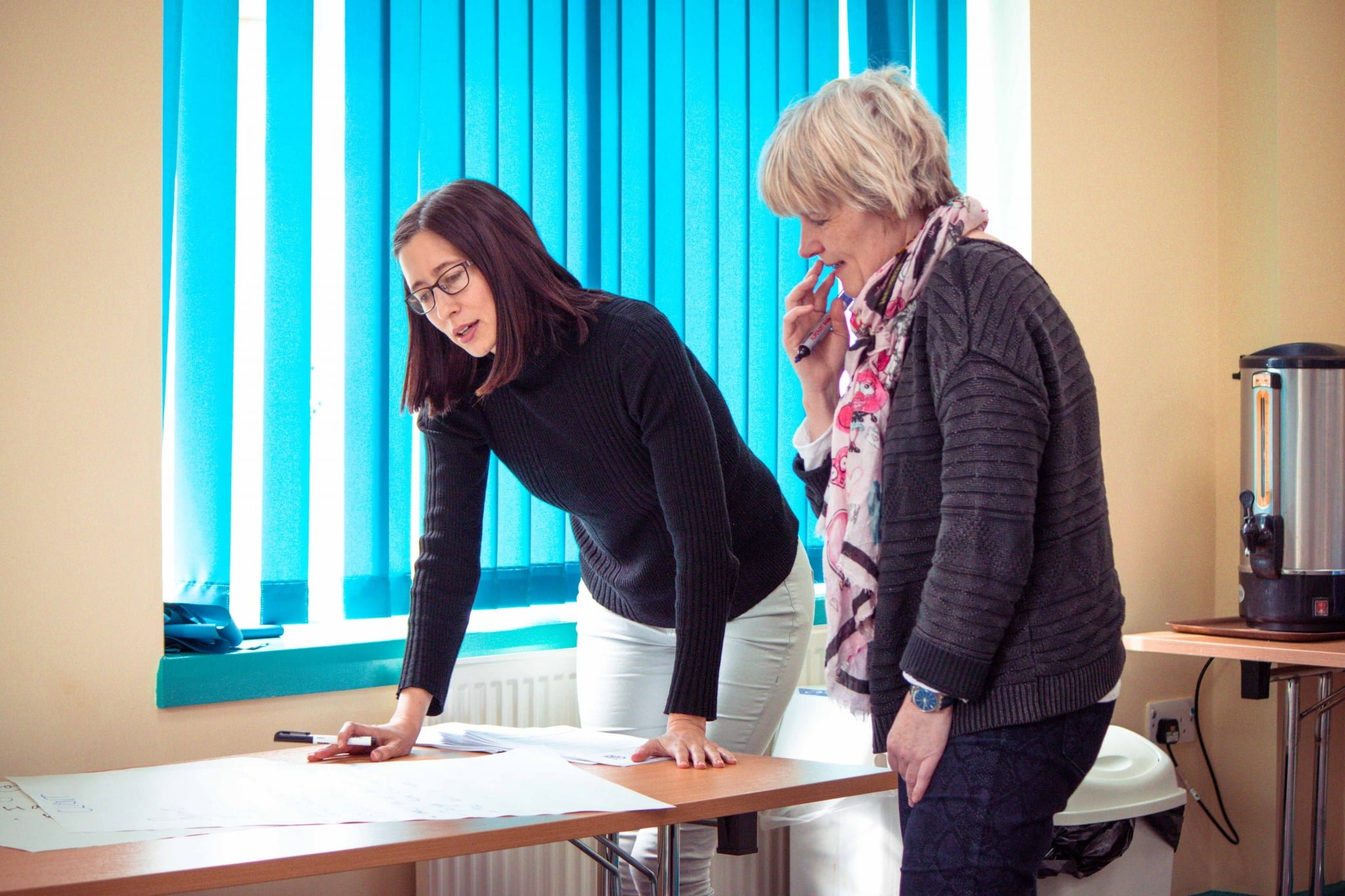 A specialist study skills tutor and student working together at a table